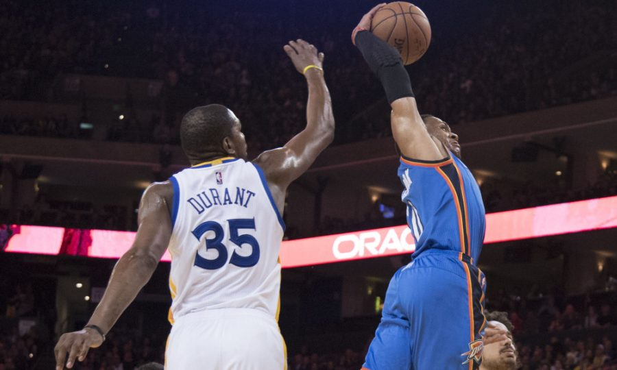 January 18, 2017; Oakland, CA, USA; Oklahoma City Thunder guard Russell Westbrook (0, right) dunks the basketball past Golden State Warriors forward Kevin Durant (35) during the third quarter at Oracle Arena. The Warriors defeated the Thunder 121-100. Mandatory Credit: Kyle Terada-USA TODAY Sports