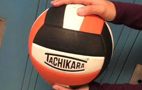 Ms. Kane Teaches Volleyball Skills to Team