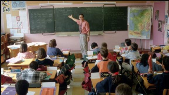 Public school classroom full of student